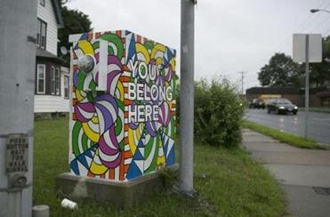 A transformer box in Pittsfield was painted with a message meant to encourage residents to remain in the area.